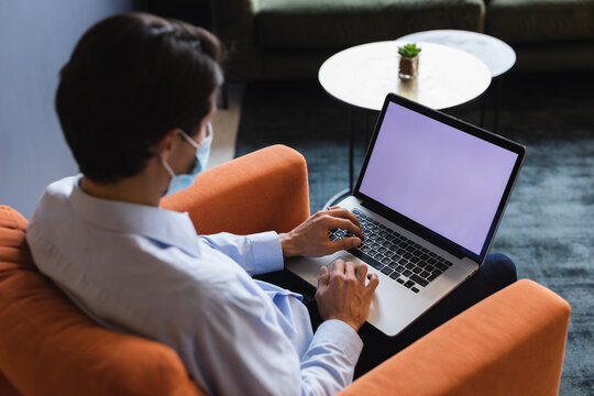 Mixed race man using laptop in an office