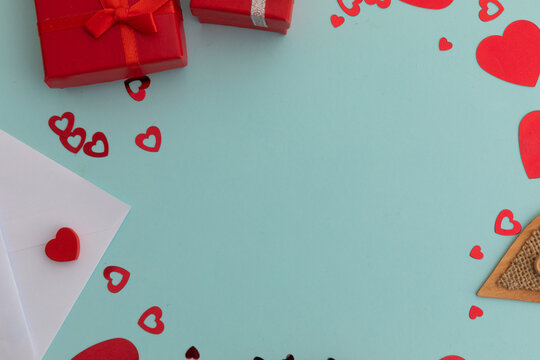 High angle view of red presents and hearts on blue background