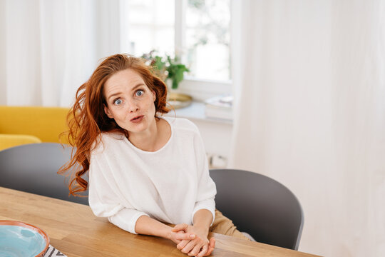 Shocked young woman staring wide eyed