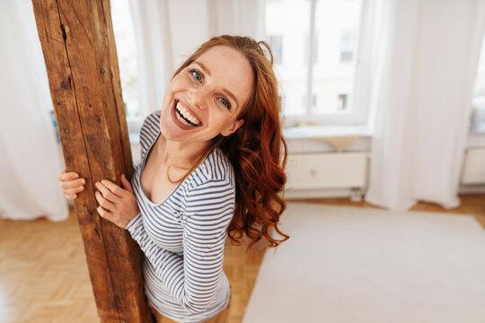 Cute fun happy young woman laughing at camera