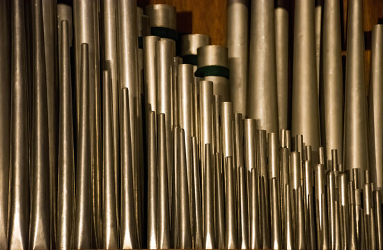 A historic pipe organ inside a church. Old musical instrument, religious music.