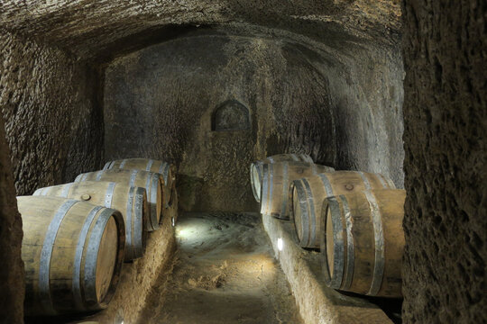 eight wooden barrles in the cellar of a syngoge in Pitigliano