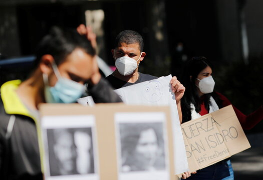 Cuban students living in Mexico and other demonstrators protest outside the Cuban Embassy in Mexico City