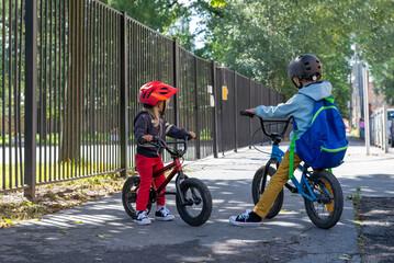 Fototapeta Two children ride the street on bicycles. Street sports. Friendship. Bmx ride.