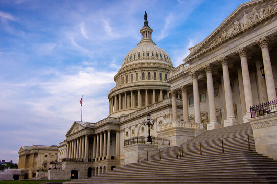 Low angle view of the east entrance to United States Capitol building in Washington DC with marble dome and stairs