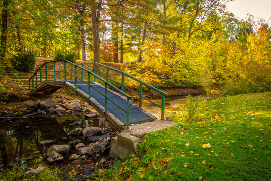 Autumn Fall Color Landscape. Small footbridge over a creek surrounded by vibrant fall foliage at a small county park in Jackson County, Michigan.