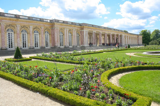 the grand trianon palace in versailles park