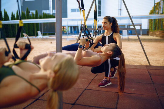Women's group and instructor, training outdoors