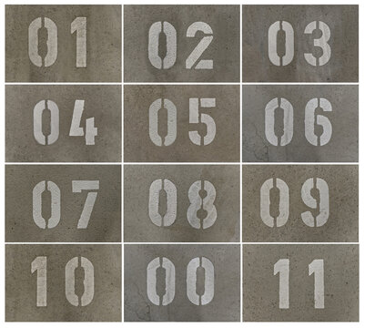 Parking lot numbers in an underground car park sprayed onto the concrete floor with a template.