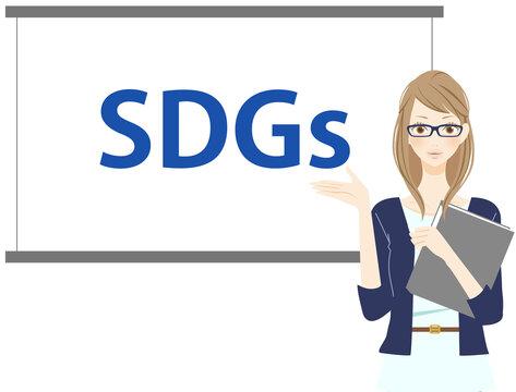 持続可能な開発目標について発表する女性 メガネ