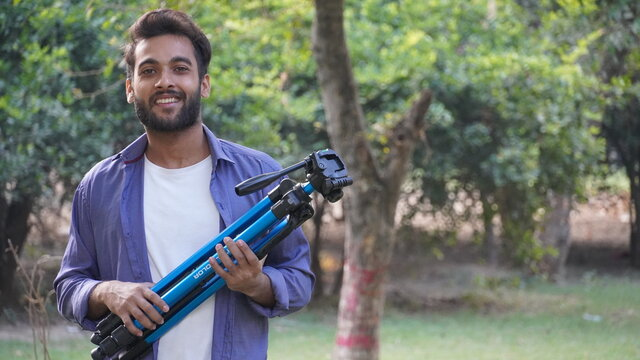 Young blogger with tripod -Indian Blogger images