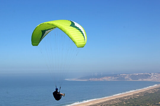 Paragliding above Salgado Beach, Portugal