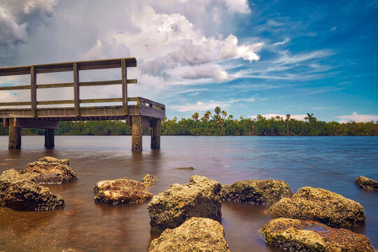 Beautiful pier scene with rocks on the shore.