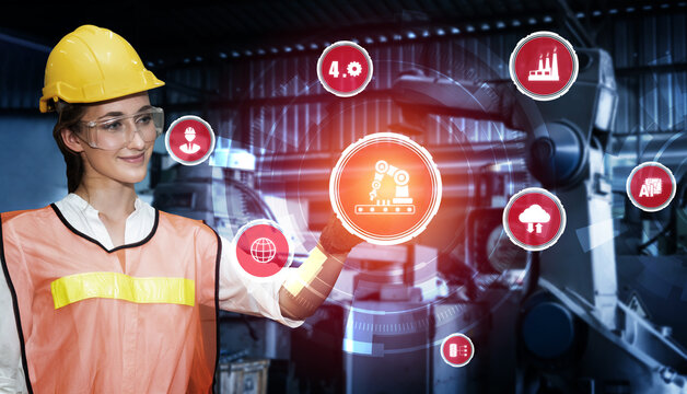 Engineering technology and industry 4.0 smart factory concept with icon graphic showing automation system by using robots and automated machinery controlled via internet network .