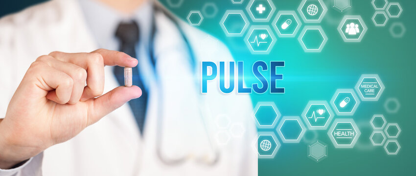 Close-up of a doctor giving you a pill with PULSE inscription, medical concept