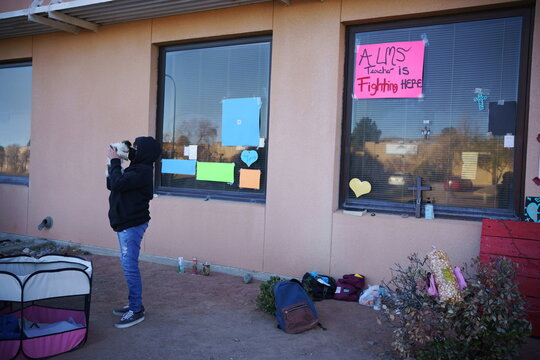 People visit patients through windows during a surge of coronavirus disease cases inLas Cruces