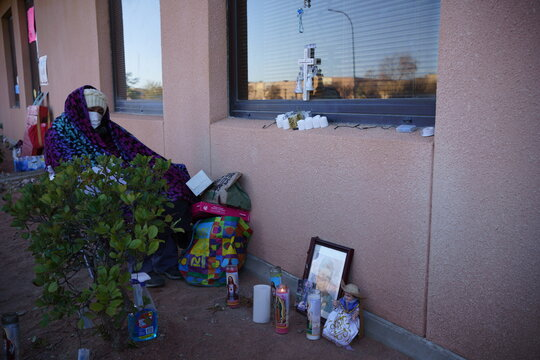 People visit patients through windows during a surge of coronavirus disease cases in Las Cruces