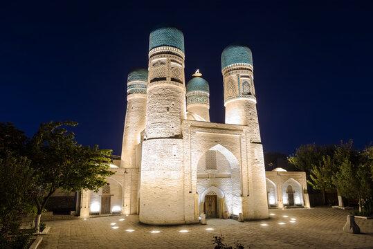Ancient Chor-Minor madrasah in Bukhara at night, Uzbekistan