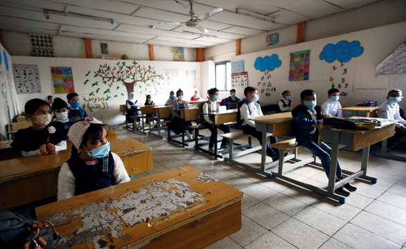 An Iraqi students wering protective mask seen in the class in the first day at school after schools reopen amid the Coronavirus (Covid 19) outbreak in Baghdad Iraq reopens schools after months of closure amid coronavirus disease pandemic