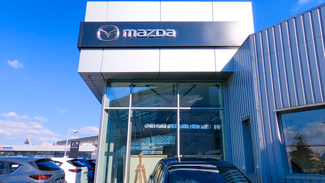Kyiv, Ukraine - August 15, 2020: retail of Mazda logo on store front