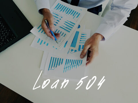 Business concept meaning Loan 504 with sign on the piece of paper.