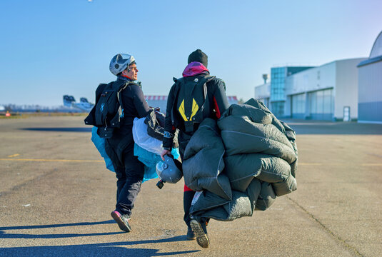 skydivers in the field after landing