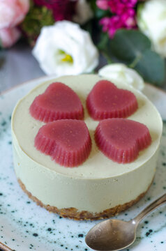 Cheesecake with matcha tea and jelly hearts
