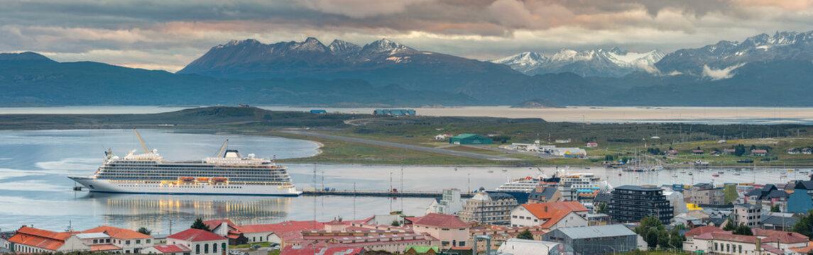 wide angle panorama of Ushauia city with coast line and mountains on horizon