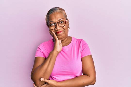 Senior african american woman wearing casual clothes and glasses thinking looking tired and bored with depression problems with crossed arms.