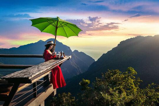 Beautiful girl making drip coffee at sunrise viewpoint in Pha Hi village, Chiang Rai Province, Thailand.
