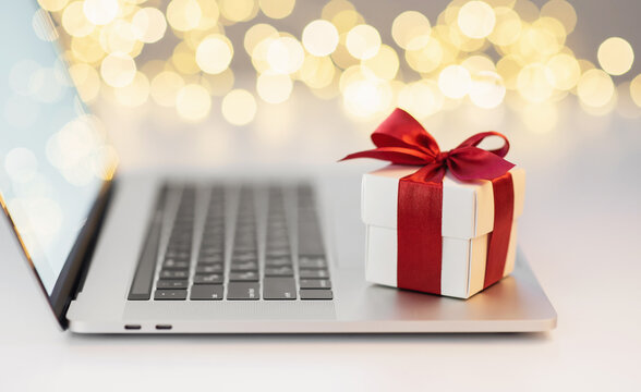 Shopping online during holidays. Ordering Christmas gifts using laptop computer. Shopping, online xmas sales, technology, business, spending money, e-commerce, holiday concept
