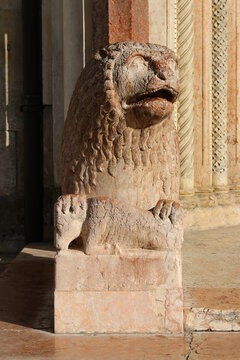 Modena, ancient statue of lion, cathedral architectural details, romanesque style, Italy, Unesco world heritage