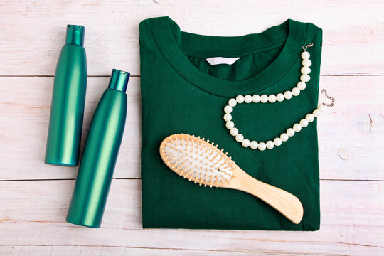 Hair care products and green female blouse
