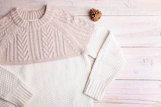 White warm knitted sweater