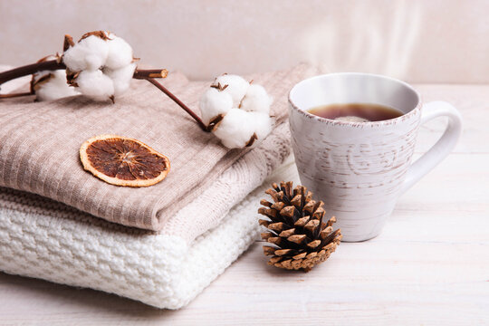 Warm winter sweaters and a cup of hot tea
