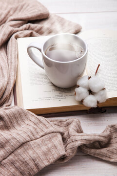 cup of hot tea and open book