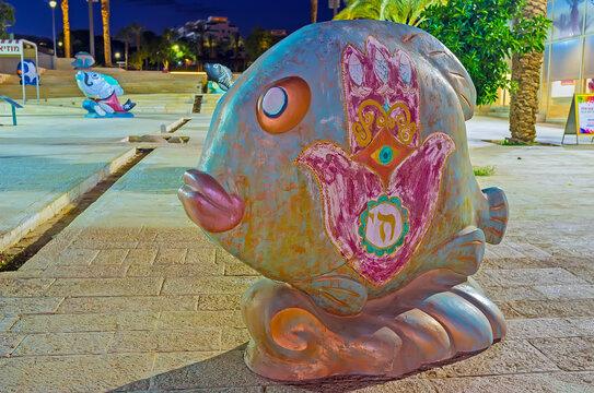 The fish with hamsa, on Feb 23, 2016 in Eilat, Israel