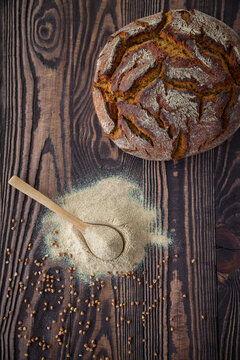 Top view spoon with buckwheat flour and bread
