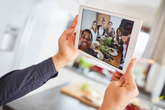 Friends make video call live stream using tablet while eating together