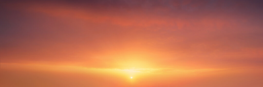 background of cloudscape at the sunset with sunshine on sky and red clouds