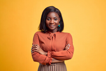 Obraz Advertising concept. Confident and smiling young african american woman crossed hands on chest, looking at camera and standing on yellow copy space background. - fototapety do salonu