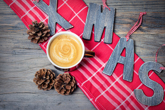 Coffee Christmas concept on wooden background.