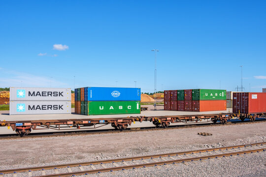 Containers and train wagons on a yard