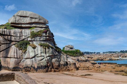 Huge unique rock formations on the Pink Granite Coast (Cote de Granite Rose), textured granite boulders near Ploumanac'h in Brittany, France.