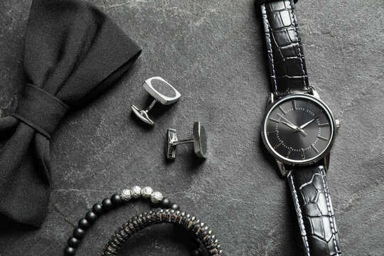 Flat lay composition with luxury wrist watch on black background