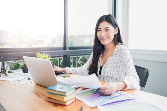 Asian woman Graphic Design Studio Drawing Ux Ui Website Technology Creative Occupation freelance advertisement marketing creating user interface with tablet computer agency working happy smiling