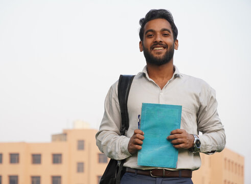 Indian Student with books at collage campus