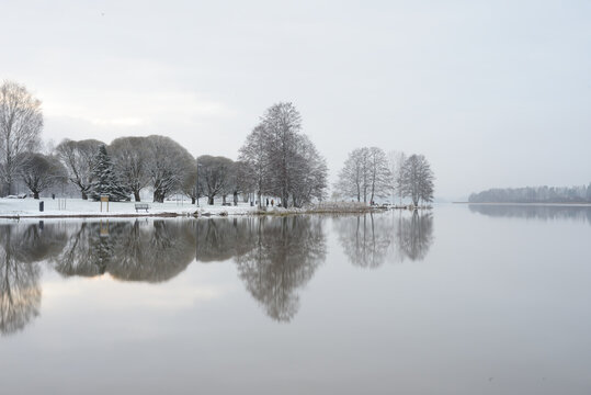 park on the shore of Lake Tuusula at the beginning of winter in Finland
