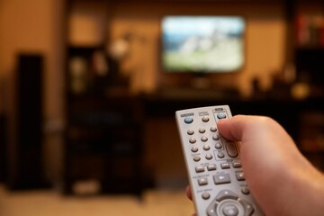 Using remote control for switching TV programs from the couch