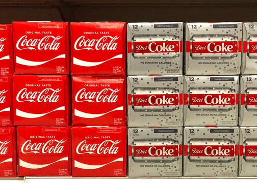 San Leandro, CA - Nov 27, 2020: Grocery store shelf with cases of regular and diet coke for sale.